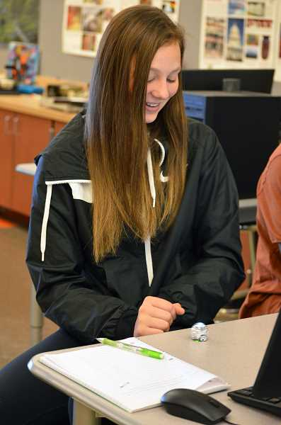 SPOKESMAN PHOTO: CLARA HOWELL  - Sophomore Keira McNamee watches as her Ozobot moves around.