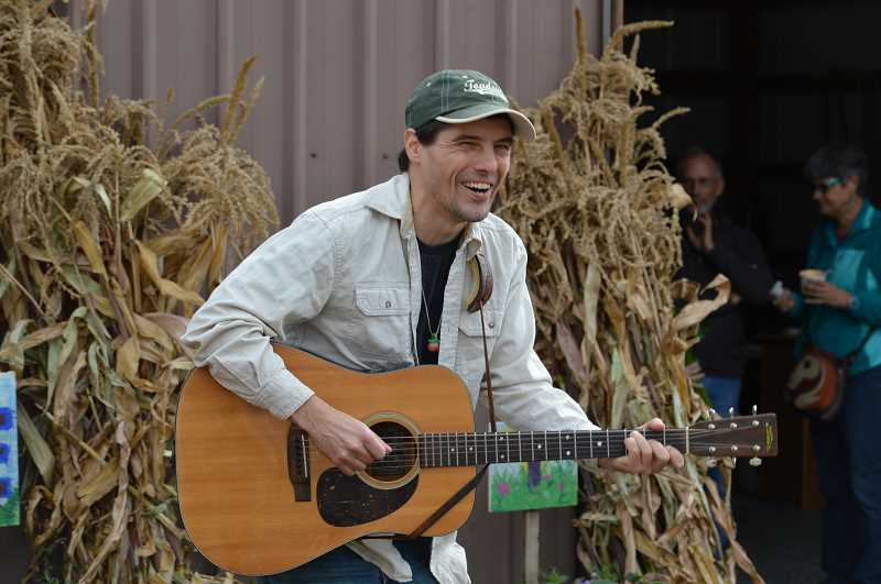 SPOKESMAN PHOTO: CLARA HOWELL  - JT plays country music for fall festival goers.