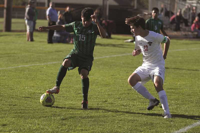 PHIL HAWKINS - North Marion junior Isaac Santiago scored one of three first-half goals for the Huskies in the team's 5-0 win over Corbett on Oct. 2. North Marion followed with a 2-0 victory against Molalla to move into second place in the Tri-Valley Conference.