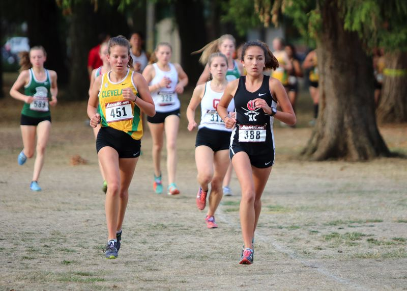 PAMPLIN MEDIA: JIM BESEDA - Clackamas' Olivia Iparraguirre (388) covered the 3.1-mile course at Lents Park in a season's best 20:17.3 during Wednesday's Mt. Hood/PIL cross country meet with Benson, Central Catholic, Cleveland, and Wilson.
