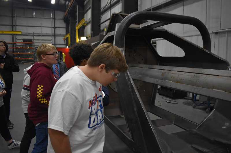 ESTACADA NEWS PHOTO: EMILY LINDSTRAND - Students at Clackamas Academy of Industrial Sciences check out machinery at Northwest Technologies during an event on Friday, Oct. 5.