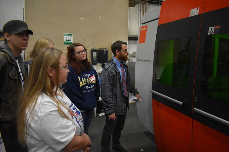 ESTACADA NEWS PHOTO: EMILY LINDSTRAND - Students watch a laser during a Manufacturing Day event at Northwest Technologies last week.