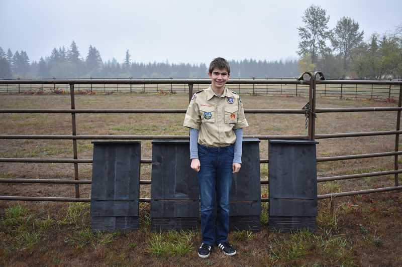 ESTACADA NEWS PHOTO: EMILY LINDSTRAND - Riley Herbert, 13, stands next to the bat boxes he created for Milo McIver State Park as an Eagle Scout project. The boxes will be place in trees in the park to provide the bats with a warm space.