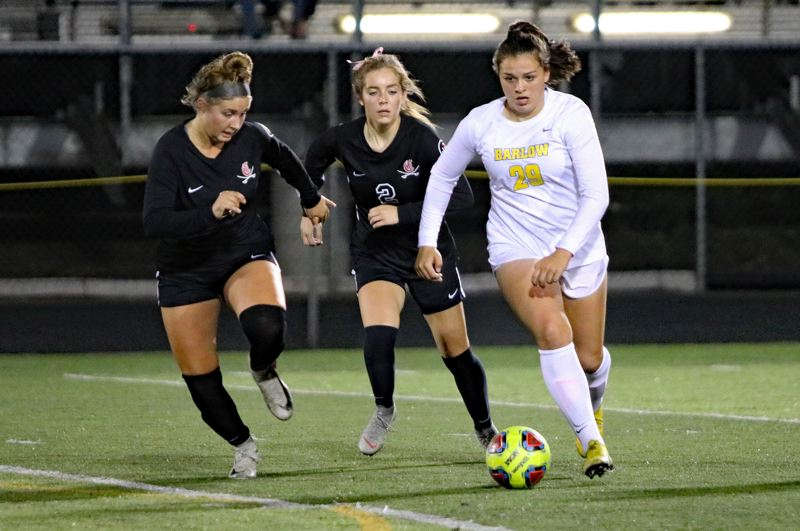 PAMPLIN MEDIA: JIM BESEDA - Clackamas' Ellie Gentry (left) and Emma Anderson (2) converge on Barlow's Abi Hoffman (29) during the second half of Wednesday's Mt. Hood Conference girls' soccer game at Clackamas.
