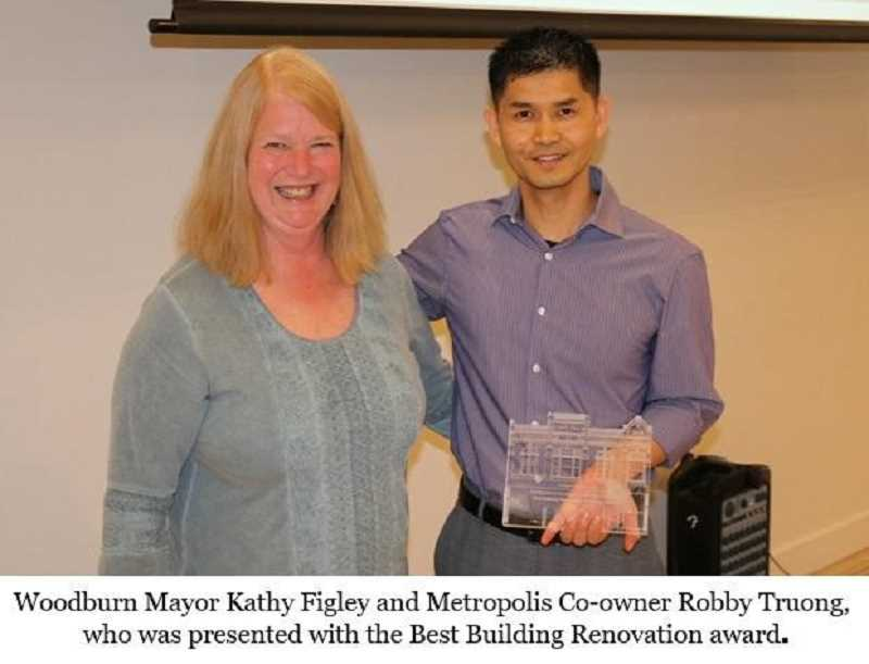 COURTESY PHOTO: CITY OF WOODBURN - The city of Woodburn received three awards last week from Oregon Main Street, including Best Building Renovation for Metropolis, which was accepted by Mayor Kathy Figley and owner Robby Truong.