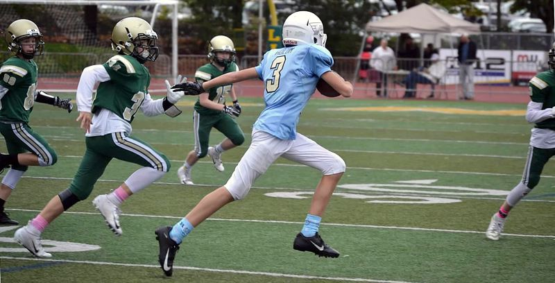SUBMITTED PHOTO - Tight end Cole Holum makes a run for the Pacer JV 7th grade team against West Linn Green on Saturday.