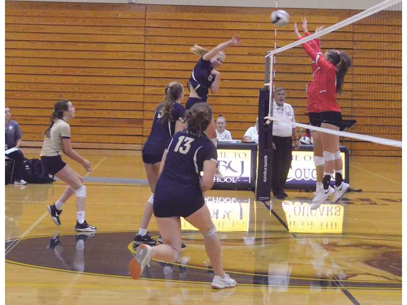 HERALD PHOTO: TANNER RUSS - Canby sophomore Daley McClellan kills the ball against Oregon City.