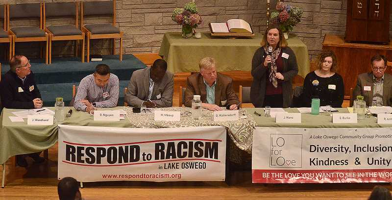 REVIEW PHOTO: VERN UYETAKE - City Council candidate Jackie Manz address the more than 150 people who attended a forum Monday night sponsored by Respond to Racism and LO for LOve. On the dais: candidates John Wendland (from left), Daniel Nguyen, Massene Mboup, Donald Mattersdorff, Manz, Emma Burke and Randy Arthur.