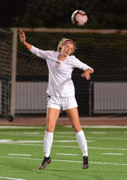 PMG PHOTO: DAVID BALL - Tualatin junior Abby Borg heads the ball during the Wolves' match at Lake Oswego.