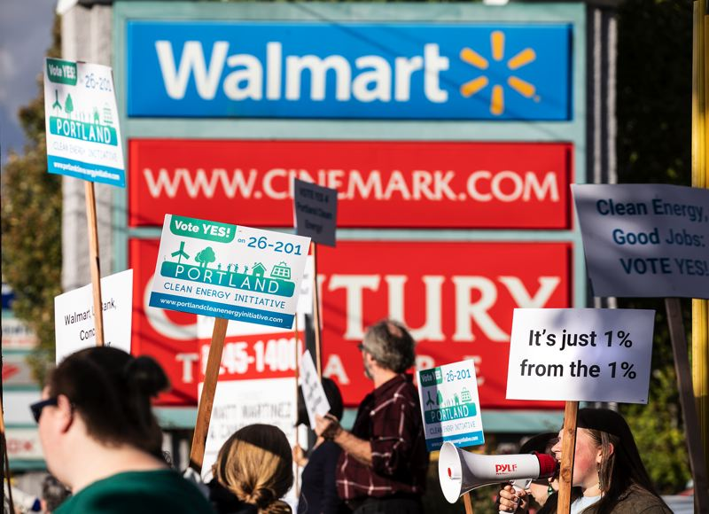 TRIBUNE PHOTO: JONATHAN HOUSE - Activists for Measure 26-201 rallied during rush hour Tuesday afternoon in front of the Southeast 82nd Avenue Walmart, in support of the creation of a Portland Clean Energy Fund.