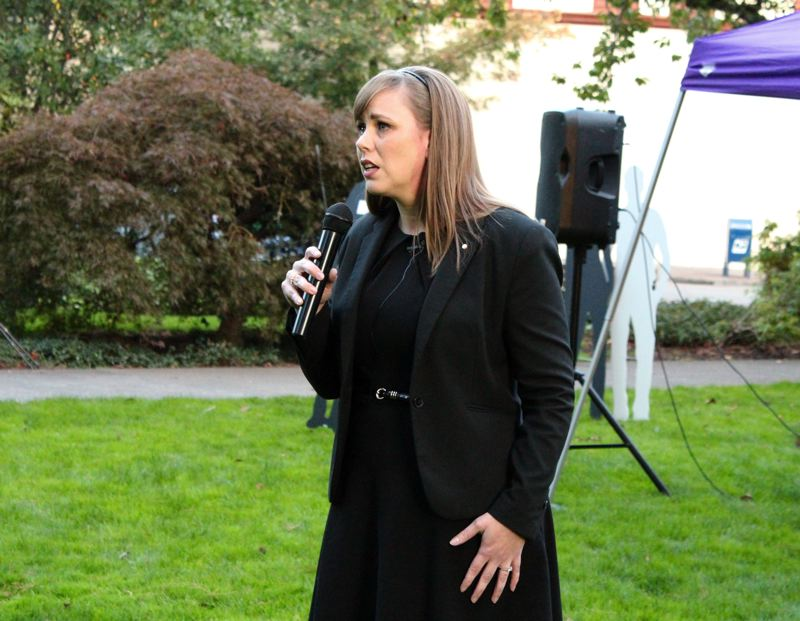 STAFF PHOTO: OLIVIA SINGER - Shannon Buckmaster of Newberg shared her story of surviving domestic violence during the vigil Tuesday evening outside of the Washington County Courthouse.