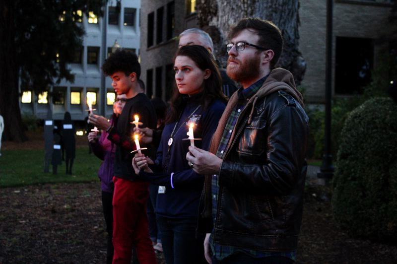 STAFF PHOTO: OLIVIA SINGER - Community members gathered in Hillsboro for the vigil which concluded with a candlelight service.
