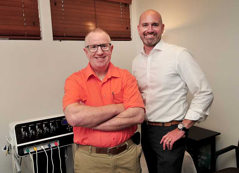 REVIEW PHOTO: VERN UYETAKE  - David Farley M.D., who is the medical director for Radiant Pain Centres, stands with company founder P. Brendon Lundberg. Radiant Pain Centres offer those with chronic pain a treatment that is drug-free, side-effect-free and non-invasive.