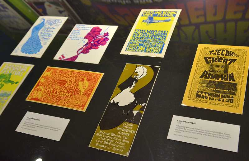 REVIEW PHOTO: VERN UYETAKE - Oregon Historical Society Museum Curator Lori Erickson says Peter Glazer's memorabilia collection, including these concert handbills, were in great condition. 'I think it's a great record of what was going on at that time,' she says.