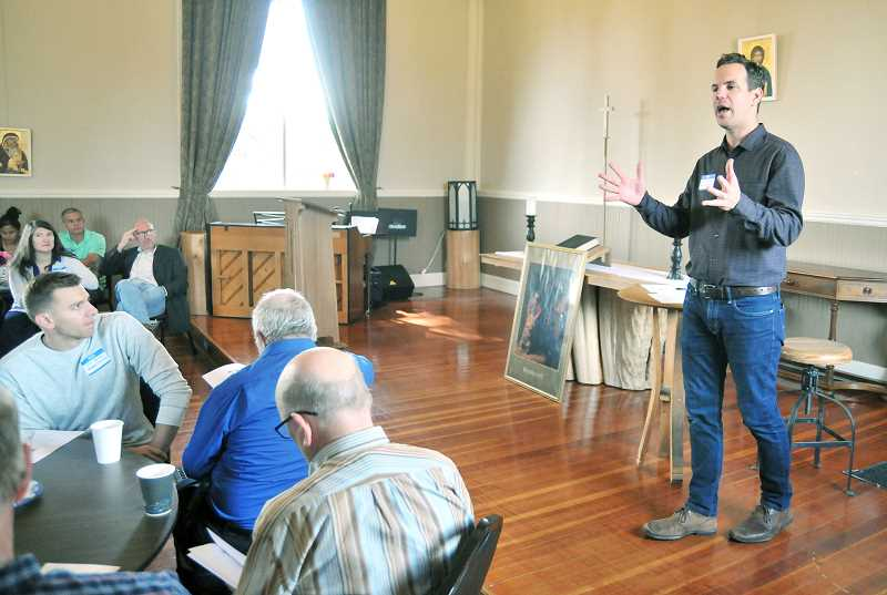 SETH GORDON - Church of the Vine priest Sean Flannery shares about the Hillside Inn during aNewberg Ministerial Association meeting last week hosted at Church of the Vine. Flannery, who serves as executive director of the inn, is recruiting support from the broader church community in Newberg to help the inn become a self-sustaining and independent nonprofit ministry.