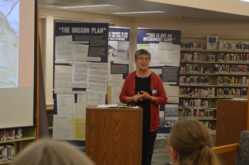 PAMPLIN MEDIA GROUP PHOTO: NICOLE THILL-PACHECO - June Schumann, the former founding director of the Oregon Nikkei Legacy Center, speaks at a special presentation at the St. Helens Public Library on Tuesday, Oct. 9. Schumann was asked to speak about the historical aspects and timeline that led to and followed the internment of Japanese people in the United States during World War II.