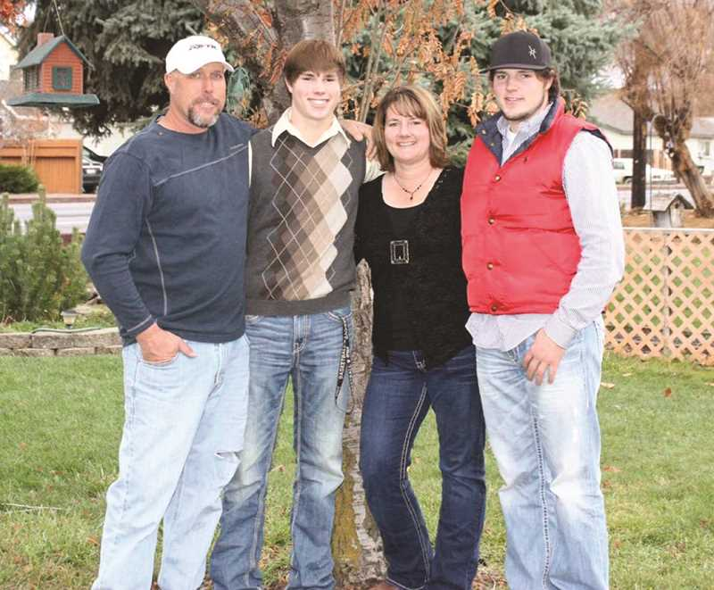 PHOTO COURTESY OF THE BARTELS FAMILY   - The Bartels family, left to right: Rich, Blake, Cathy and Travis.
