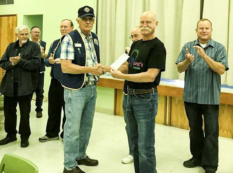 PHOTO COURTESY OF JIM RODOSEVICH - The Knights of Columbus local council Grand Knight Steve Schilling, left, presents a $2,067.23 check to Jim Rodosevich, president of St. Vincent de Paul of Crook County.