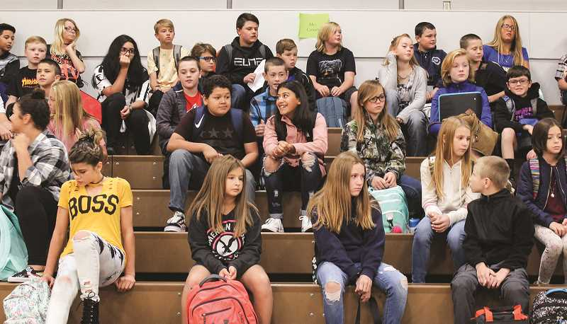 CENTRAL OREGONIAN - Middle school students congregate in the gymnasium on their first day of the 2018-19 school year. Enrollment is down slightly overall from last school year.