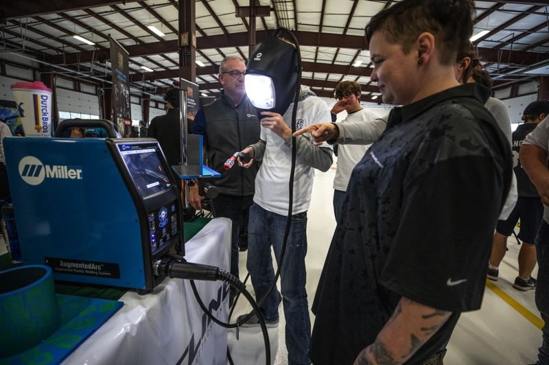 PAMPLIN MEDIA GROUP: JONATHAN HOUSE - Students try out a different virtual welder, as  companies linked to OMIC try to entice students into careers in manufacturing.