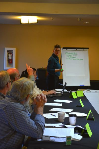 SPOTLIGHT PHOTO: COURTNEY VAUGHN - Alison Hart takes input from Columbia County Tourism Committee members during a meeting Tuesday, Oct. 9.