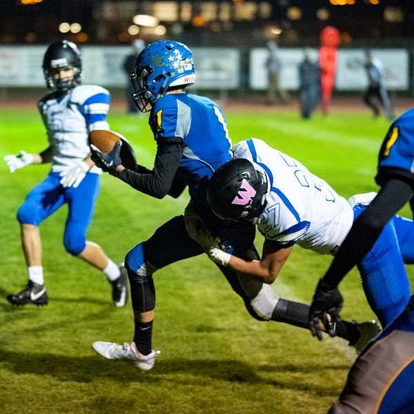 LON AUSTIN/CENTRAL OREGONIAN - Dominic Langley crosses the goal line with a touchdown to pull the Cowboys to within two-points of the Woodburn Bulldogs. Crook County came up just short on their two-point conversion attempt, which turned out to be the difference in the game.