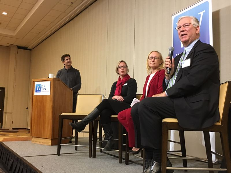 TIMES PHOTO: PETER WONG - Doug Kelsey, right, general manager of TriMet, makes a point during a panel discussion of housing and transportation at a Westside Economic Alliance forum Oct. 3 at Embassy Suites in Tigard. Others from left: Carl Guardino of Silicon Valley Leadership Group, moderator; Molly Haynes, Kaiser Permanente, and Lynn Peterson, Metro Council president-elect.