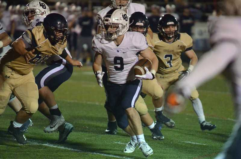 HERALD PHOTO: TANNER RUSS - Lake Oswego junior Casey Filkins was a big part of the Laker's offensive presence in the first half. Lake Oswego defeated Canby 33-12 at the end of its showdown on Friday, Oct. 12.