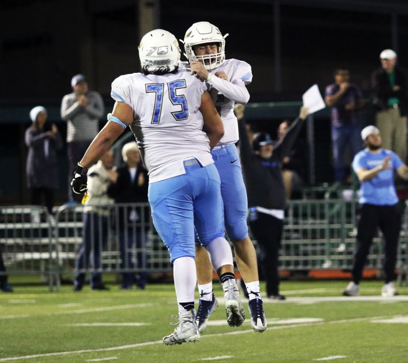 TIMES PHOTO: DAN BROOD - Lakeridge junior lineman Keoni Hepa (left) and senior quarterback Charlie Maynes celebrate following a Maynes touchdown pass during Friday's game at Tigard.