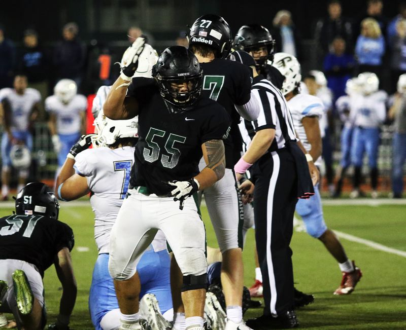 TIMES PHOTO: DAN BROOD - Tigard senior Isaia Porter celebrates after making a tackle during the Tigers' game with Lakeridge.