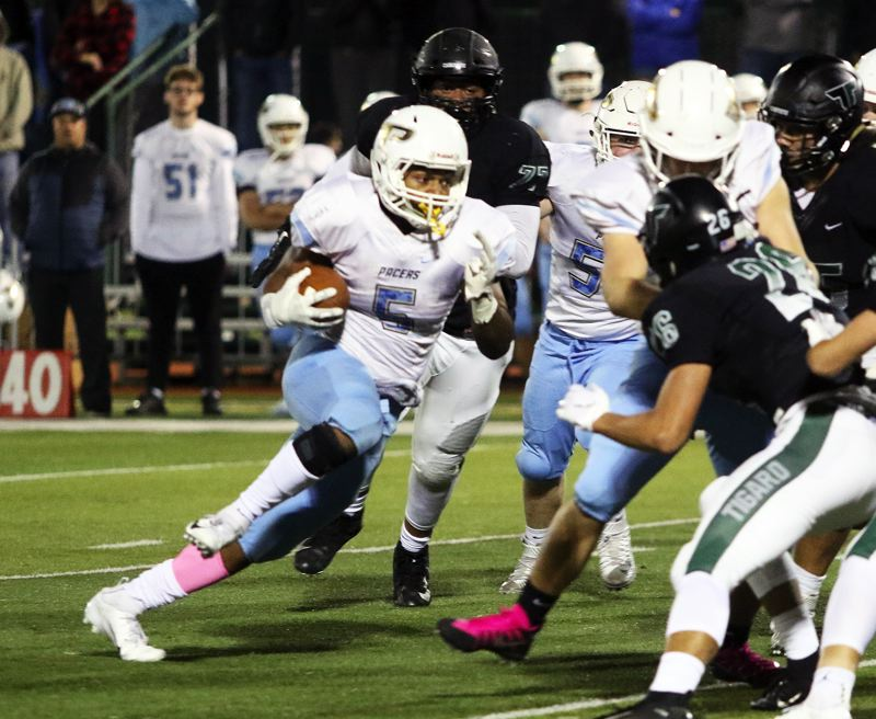 TIMES PHOTO: DAN BROOD - Lakeridge junior Jalen John (5) picks up speed during the Pacers' 48-38 win at Tigard on Friday.