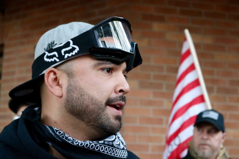TRIBUNE PHOTO: ZANE SPARLING - Patriot Prayer leader Joey Gibson speaks with reporters on Saturday, Oct. 13 in downtown Portland.