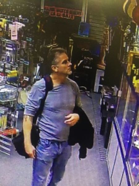 POLICE PHOTO - Police say this man stole a black electric guitar from Eastside Music in Gresham.