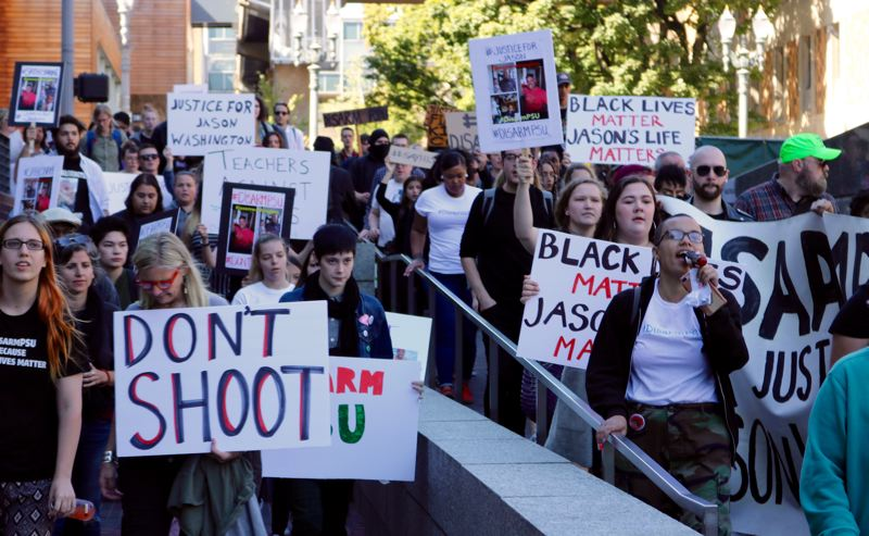 TRIBUNE PHOTO: ZANE SPARLING - Protesters for Jason Washington march through the Portland State University campus on Sept. 24.