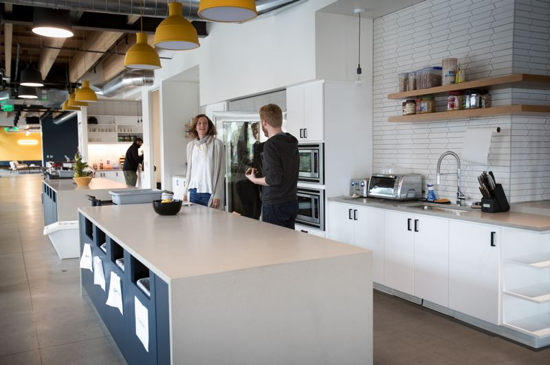 PAMPLIN MEDIA GROUP: JAIME VALDEZ - The light-filled communal kitchen at Vacasa's new office at the Heartline.