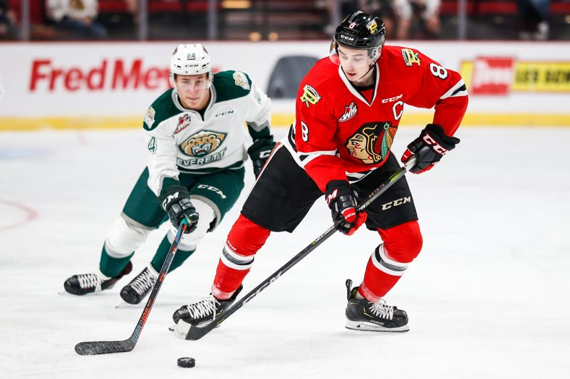 COURTESY: PORTLAND WINTERHAWKS/BEN LUDEMAN - Cody Glass handles the puck for the Winterhawks during Sunday's loss to the Everett Silvertips at Moda Center.