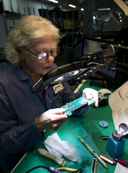 JAIME VALDEZ - Screaming Circuits employee Candace Bly assembles a circuit board at the Canby facility.
