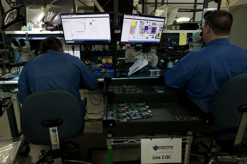 JAIME VALDEZ - Screaming Circuits employees make circuit boards at the Canby facility.