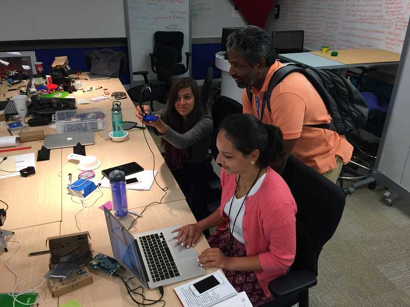SUBMITTED PHOTO  - High school students apply rapid prototyping processes in their work experiences at Intel.