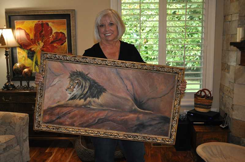 PHOTO: BLAIR STENVICK - This painting of a lion at the Oregon Zoo is among JJ Gattuccio's favorite pieces.