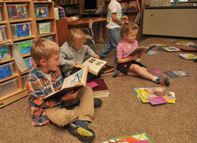 SPOKESMAN PHOTO: VERN UYETAKE  - Kids in the classroom participate in some reading time.