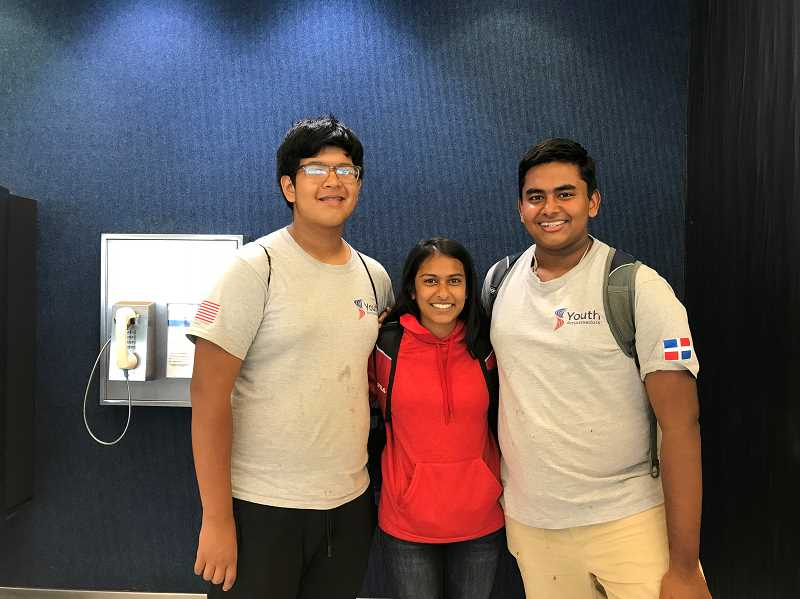 COURTESY: MAYA BEDGE - Maya Bedge, center, poses at the Houston International Airport with two fellow youth ambassadors before departing for the Dominican Republic.