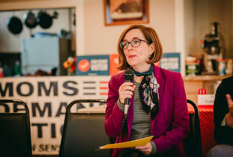 COURTESY PHOTO: KIMBERLY KIMBLE - Oregon Gov. Kate Brown addresses a crowd of about 60 people before a Friday, Oct. 12, political speed dating event in Hillsboro organized by Mom's Demand Action for Gun Sense in America.