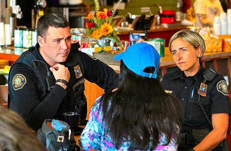DAVID F. ASHTON - Officers Steve Sharp and Carrie Hutchinson listen to neighbors during an early October afternoon Coffee with a Cop informal discussion at Sellwoods Blue Kangaroo coffee shop.