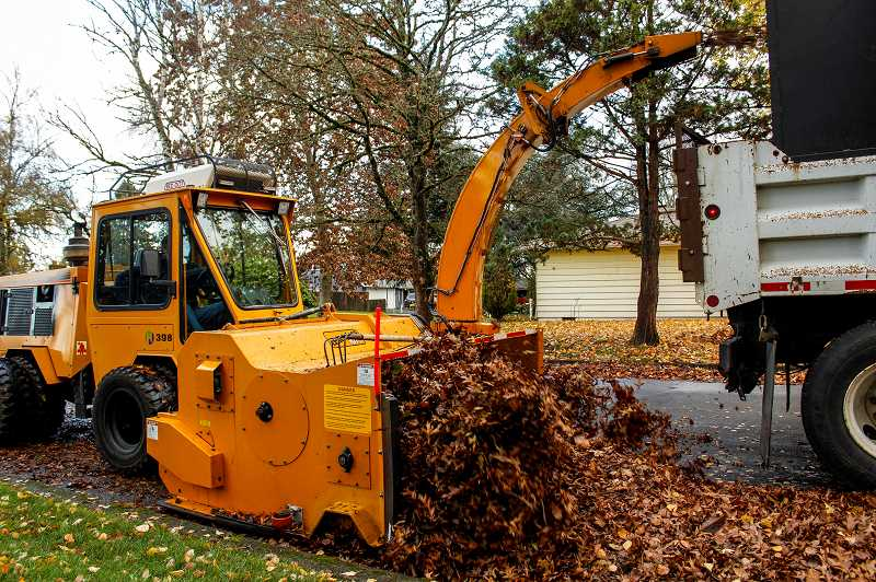 STAFF FILE PHOTO - Hillsboro Public works crews collect leaves during a leaf pick-up in 2016. The city will begin picking up leaves Nov. 1. Two drop-off days are also planned.