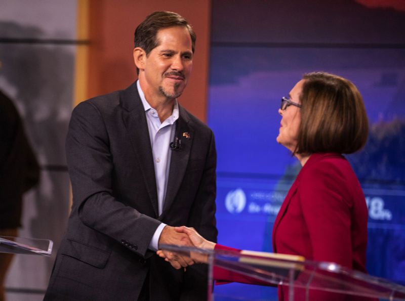 JONATHAN HOUSE/PORTLAND TRIBUNE - Left to right, Oregon Rep. Knute Buehler, GOP nominee for governor, and Gov. Kate Brown shake hands after the final gubernatorial debate Oct. 9 at the KGW TV studio in Portland.
