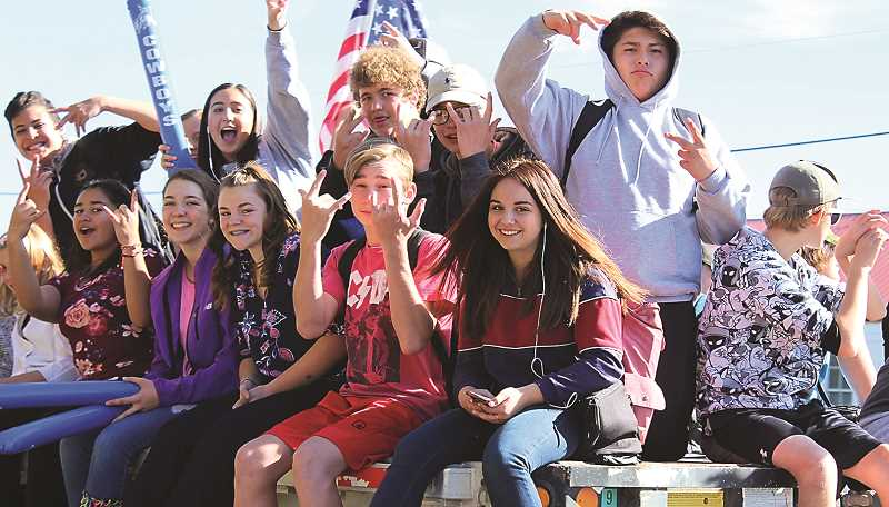 HOLLY SCHOLZ/CENTRAL OREGONIAN  - Students rode on the back of flatbed trucks for the Thursday afternoon noise parade.