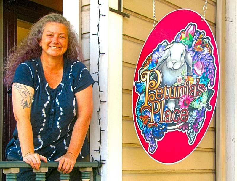 ERIC NORBERG - Proprietor and animal advocate Carolyn Ackerman welcomes customers to her new shop Petunias Place in Sellwood.