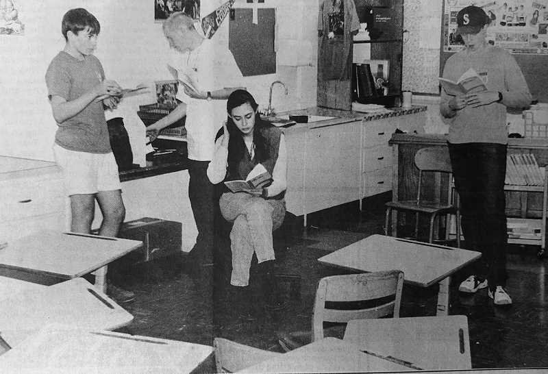 """CENTRAL OREGONIAN FILE PHOTO  - Oct. 14, 1993: Local performances are doing without a stage since the one at Ochoco Elementary was blocked off for classroom space this year. Above, cast members from CCHS' """"The Crucible"""" push aside desks and rehearse in a classroom. The actors are, from left, George McGriff, Brandon Adams, Nicole Potter and Jimmie Hupp."""
