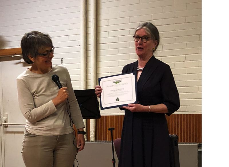 SUBMITTED PHOTO - Jane Morrison, chairperson for the Jennings Lodge Community Preservation Award Committee, honors Jessica Scarborough at the Sept. 25 Community Planning Organization meeting.